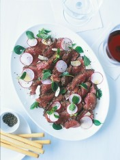rare beef with radish, oregano and lemon
